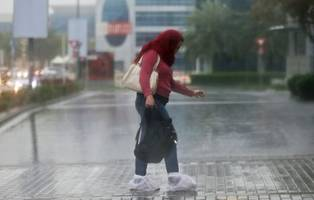 uae weather: heavy rain falls across the country as police issue emergency alert
