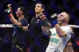 Usman batters Covington, Volkanovski claims title at UFC 245