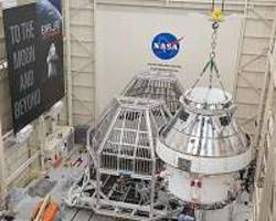 preparing to test orion spacecraft requires a big plane, huge cranes and a vacuum cleaner