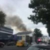 emergency services responding to fire in hamilton cbd