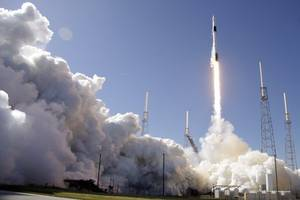 spacex's reusable rocket launches communication satellite