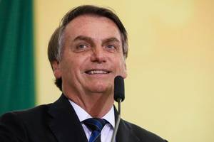 far-right brazilian president defends son in corruption probe