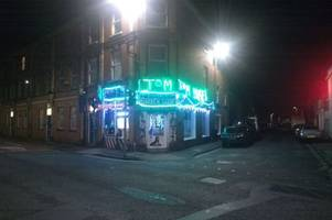 barbershop owner finally removes christmas lights hours before big day after defying orders from gloucester city council
