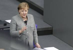 merkel plans turkey trip to preserve migrant pact, newspaper reports