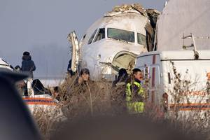 kazakhstan holds day of mourning for almaty plane crash victims