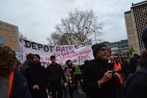 thousands march in paris to protest pension reform plan