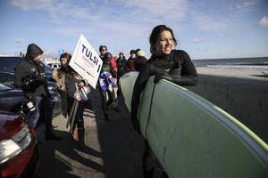 tulsi gabbard makes waves in nh goes surfing in chilly waters