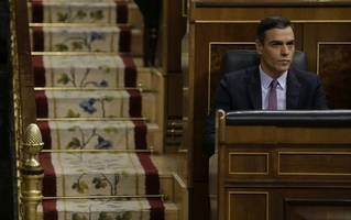 spanish parliament debates formation of left-wing government