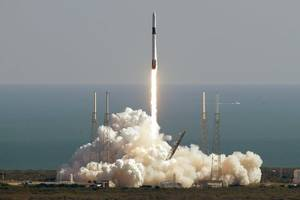 spacex launches 60 more satellites in attempt to tone them down