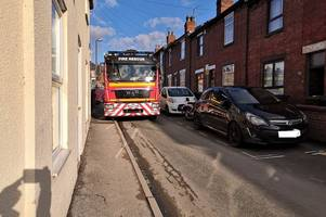 live updates as police and fire crews rush to lincoln building site as man stuck under digger