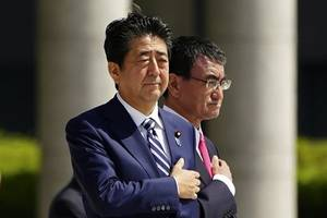 japan pm heading to middle east as planned, warship dispatch ordered