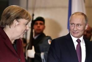 merkel, putin discuss middle east flashpoints at kremlin meeting