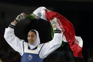 iran's only female olympic medallist says she has quit country