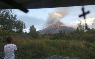 tiny philippine volcano ejects smoke and ash, villagers flee