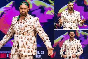 Tyson Fury wears suit full of pictures of himself for Deontay Wilder press conference