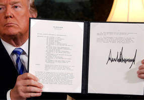 What does triggering the Iran nuclear deal dispute mechanism mean?
