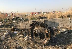 iran airplane shot down: two missiles strike the airplane, photos state