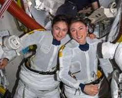 Crew ready for spacewalk while working Earth and Fire Research