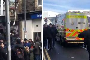 football fans screaming 'we do what we want' and throwing toilet paper occupy newport city centre street