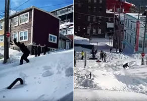 Canadians Snowboard Down the Streets of St Johns After a Massive Blizzard