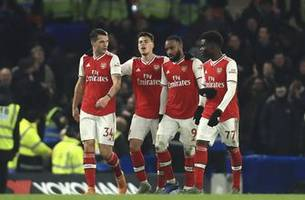 Arsenal fights back for draw on wild night in Premier League