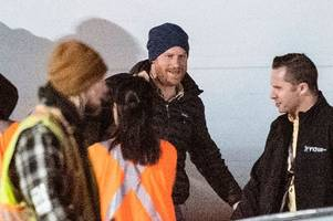 Smiling Prince Harry touches down in Canada to join Meghan and son Archie