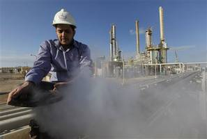 oil slides as iea predicts surplus, libya disruption concerns fade