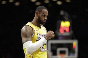 james records 10th triple-double, lakers beat nets 128-113