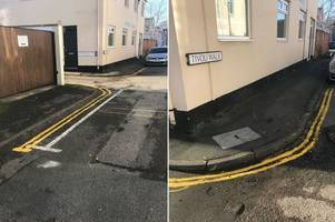 mystery man in hi-vis is drawing his own double yellow lines on residential street - leaving neighbours shocked