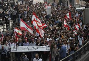 protesters in lebanon mark 100-days of revolution with beirut marches