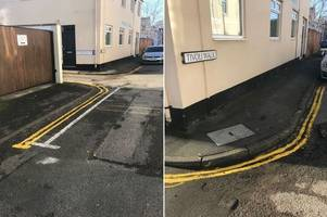 Anonymous painter draws their own double yellow lines on street