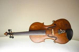 The story of the violin that found its way from Auschwitz to Surrey