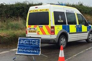 driver in hospital with serious leg injury after crash near helston