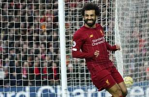 salah scores twice as liverpool power 22 points clear