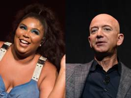 amazon ceo jeff bezos and music sensation lizzo apparently hung out during the super bowl (amzn)
