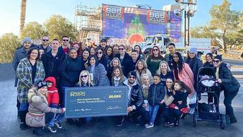 naqvi injury law donates $20,000 to kluc toy drive