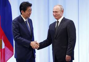 japan pm abe vows russia peace treaty talks at rally for disputed islets