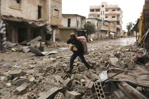syrian troops gain territory in push to control key highway