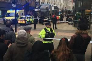 Two people stabbed on busy Manchester city centre street