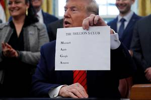 Trump made a special sign to show reporters that the initials of the 4 most valuable stocks spell MAGA
