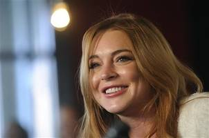 is lindsay lohan back in abu dhabi after announcing she was leaving dubai?