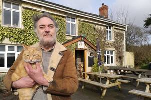 inside the 'off-grid' pub where customers serve the drinks and the cat's called hitler
