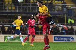 torquay united boss 'keeping tabs' on exeter city defender gary warren after successful loan spell