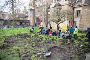 trinity college responds to extinction rebellion criminal damage on front lawn