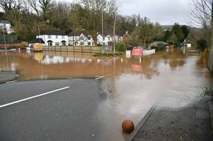 motorists told not to remove 'road closure' signs to venture through flood water in gloucestershire and monmouth