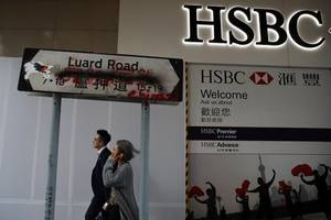 hsbc net profit falls 53%, bank to sell assets in overhaul