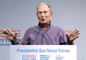mike bloomberg defensive against campaign rivals