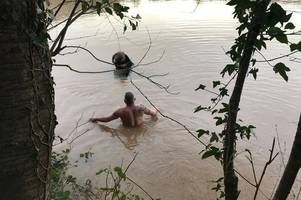 pictures reveal incredible moment rescuers saved woman after she spent all night on roof of her car in monmouth flooding