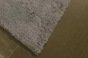 Aldi shopper's 'grey' bathmats cause fierce debate as others claim they are purple