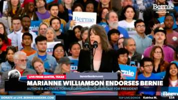 marianne williamson switches 2020 support from andrew yang to endorse bernie sanders in fiery speech